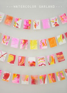 make a beautiful garland with liquid watercolors & q-tips ~ these were made by 4yr olds!