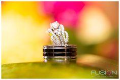 Detail shot of bride and grooms wedding rings.