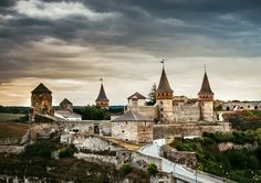 This castle now sits in Kamianets-Podilskyi, Ukraine.  This castle was originally built to protect a bridge connecting bridge.  It obviously must have been an important bridge to justify this type of defense.