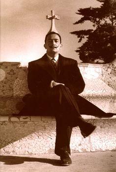 Salvador Dalí sitting on a trencadis bench at Park Güell, Barcelona. Catalonia.