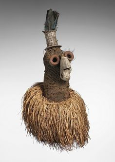 Africa | Mask from the Biombo people of Lusambo province D.R. Congo | ca early 20th century | Vegetable fibers, feathers, bone