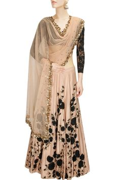 Peach and black embroidered lehenga set presents available only at Pernia's Pop Up Shop.