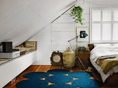 Bright and Global Attic Bedroom