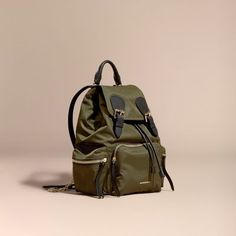 A lightweight showerproof rucksack with cushioned and polished metal chain shoulder straps and leather trims. Inspired by the fabric of the Burberry trench coat, the bag is made from durable nylon woven in a compact gabardine construction.