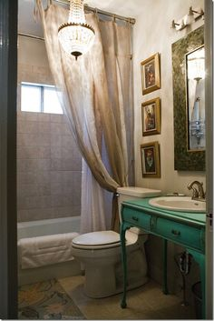 this looks like a small bathroom made to look large and elegant. I could do that!