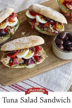 LIfe's a picnic with this fresh Tuna Salad Sandwich. French rolls piled high with Mediterranean flavors pair perfectly with a warm summer breeze or the salty ocean air. Learn how to whip these up for your next outing!