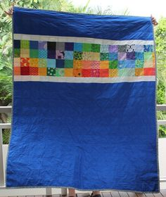 Nice quilt back making use of leftover squares from the front.