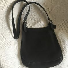 Cross body black leather coach bag Black with silver hardware. Adjustable strap. Inner zipped pocket. Perfect for a day in the city. Coach Bags Crossbody Bags