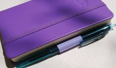 Quick and easy notebook pen holder via instructables