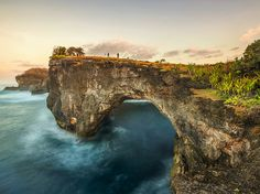 Waves meet rocky shores on the Indonesian island of Nusa Penida [Photo by Zacho Zacho, National Geographic Your Shot]