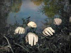 hands in a pond while youre focused on outdoor halloween decorations have a go at this idea place fake hands into a pond a fountain or any contrived