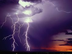 Lightning Over Las Cruces  Photograph by Lionel Brown, Getty Images    Two large lightning bolts strike the ground near Las Cruces, New Mexico. Though human eyes perceive the opposite, lightning moves from the ground up to the cloud.