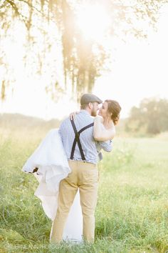 Romantic bride and groom portrait. Groom carrying the bride princess style for a sweet portrait. Photography by Charleston wedding photographer Catherine Ann Photography