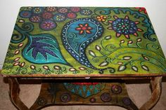 If you're feeling the itch for a new DIY project, here's an idea from Funky Home Décor that you might just like. Hand paint the top of your coffee table wi