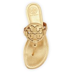 Tory Burch Tory Burch Miller Metallic Logo Thong Sandal ($205) ❤ liked on Polyvore featuring shoes, sandals, gold metallic sandals, flat shoes, flats sandals, metallic thong sandals and gold sandals