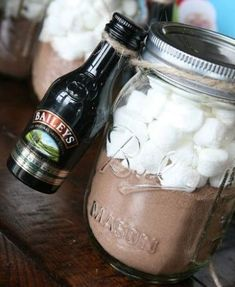 Christmas Gifts in a Jar -  Baileys with Hot Chocolate >> I made these last year for my coworkers, and they were a big hit!  I ended up hot gluing the baileys to the lids of the mason jars because they kept slipping off with just the twine.  I added a cute gift tag and done!  The whole project cost me about $30 to make 16.  The most expensive part was the jars.