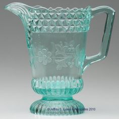 WILDFLOWER WATER PITCHER, apple green.   8 1/2 h overall, 5 dia.