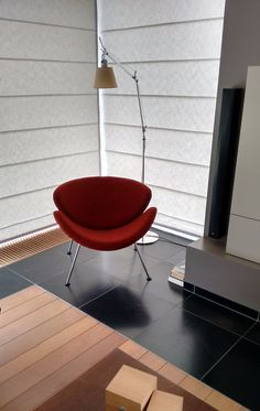 Red Orange Slice chair designed by Pierre Paulin for Artifort