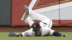 Pablo Sandoval made headlines with his three home runs in the San Francisco Giants' 8-3 win over the Detroit Tigers to open the World Series, but Gregor Blanco's contributions with the glove were also important. Here he is making a diving catch on a fly ball by Miguel Cabrera in the third inning.