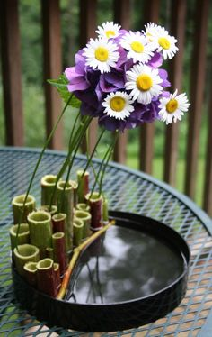 Love his use of the tubes (Japanese knotweed). Am also in awe of his vase collection! Keith Stanley 365 Day Ikebana project