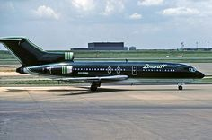 """Braniff International Boeing 727-30C N310BN in Perseus Green Ultra Scheme at Dallas-Fort Worth, July 1979. This aircraft was previously with Lufthansa as D-ABIW """"Bielefeld"""" (1967-79). (Photo: Aris Pappas, Copyright: Braniff Flying Colors Collection)"""