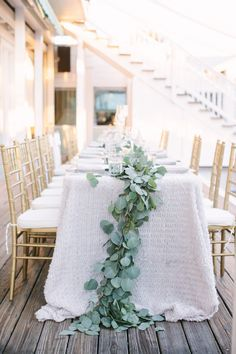 Cascading centerpiece (Floral Designer: Nouveau Flowers) - Katie and Patton's Seaside Beach Wedding by It's a Shore Thing Wedding & Event Planning (Event Planner) + pure7studios - via Grey likes weddings