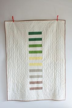 "Oh my! The wonderful simplicity knocks my socks off here in ""Leo + Elpida's Quilt"" by Season Evans. The colors and the quilting (looks like a giant knit sweater) are both fabulous! Machine pieced; machine quilted; 45"" x 60"" (2012)."