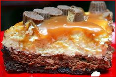 Hugs & CookiesXOXO: CARAMEL TOPPED DOUBLE LAYER CHOCOLATE CHEESECAKE WITH PEANUT BUTTER CUPS AND OREO CRUST!
