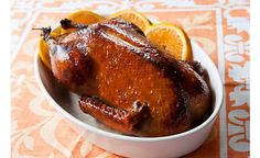 Marinate a whole duck overnight in orange juice and honey for easy French duck a l'orange. D'Artagnan