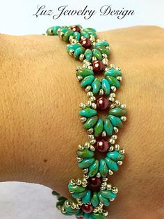Beadwork bracelet with beautiful brown pearl, green super duo beads and gold seed beads, weaved into a string of sweet little shells. Measure: 7 inches