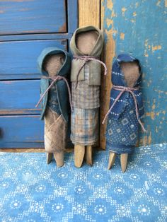 Primitive clothespin dolls. Would be good with old pins and faded denim.
