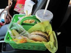 Dollar store shower caddies are great to have around for eating in the car.   33 Genius Hacks Guaranteed To Make A Parent's Job Easier by Lynne Snell-Manners