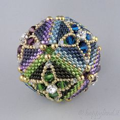 Level: Intermediate.  Technique: beading  Material requirements: 15o seed beads, 11o delica, 2,5mm and 4mmcrystal bicones , chaton montee You can choose how to build it : sphere or cube !!  Easy to read and understand pattern with full color step by step diagrams and written instructions. After notification of sale and payment the PDF will be available for download