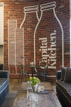 Rustic and Industrial Elements Interior Kitchen Capital Restaurant with Logo on Brick Wall Decor - Modern Cafe Interiors Design Australian Interior Design, Cafe Interior Design, Interior Design Awards, Brick Interior, Interior Shop, Church Interior, Interior Walls, Café Design, Rustic Design