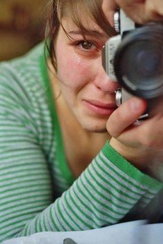 Sherri Ocaso - Woman photographer crying, watching the killing of dolphins in Taiji, Japan