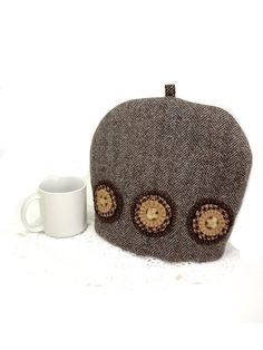 Here is a rustic tea cozy hand made from a vintage, coat weight brown herringbone wool. This is an very thick, double woven wool- an unusual
