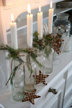Wine bottles with tall candles...great for a front entrance