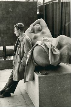 Henri Cartier-Bresson, Man Leaning against a Sculpture