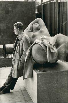 Henri Cartier-Bresson, Man Leaning against a Sculpture