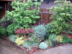 イングリッシュガーデンをベースにした華やかな庭 Photo.2