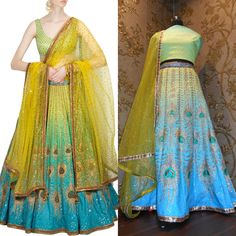 This set features a raw silk blue and green shaded flared lehenga in raw silk base crafted with gold embroidery in a setting of peacock artwork all over. It is paired with blouse with floral sequins embroidered bootis all over. It comes along with glitter work net dupatta.  Code : S340 Category : Lehenga Item Title : Blue and green peacock artwork & printed lehenga set with yellow glitter work on dupatta. Size : Free size Colour : Multi-color Fabric : Net, Raw silk Weight : 150..