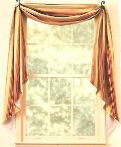 Piece of cake.  Just throw a piece of print, solid or lace fabric over two hooks and you have a great window treatment.