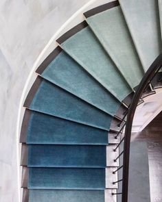 This gradient runner adds even more intrigue to an already beautiful architectural element! The ombre look is booth satisfying to the eye and totally unique! Interior designed by drew McGukin, Carpet designed by Jamie Stern Design.#drewmcgukin #sginspo #stairrunner #interiordesign #interiordesigner #beautifulhomes #homeinspiration #stayinspired #gradientrug #colorcrush