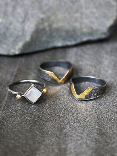 Golden Moon Ring Set | Handmade by Nichole McIver, stones hand set, gold hand applied. Beautifully crafted ring set; with interlocking design. Features an oxidized silver base, center moonstone, and gold accenting.   *ACANTHUS  **Please Note, each piece will vary slightly.