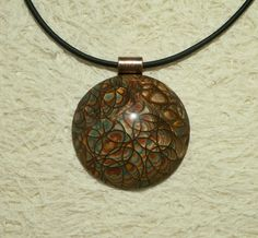Mokume Gane pendant - polymer clay dome style | Metallic col… | Flickr