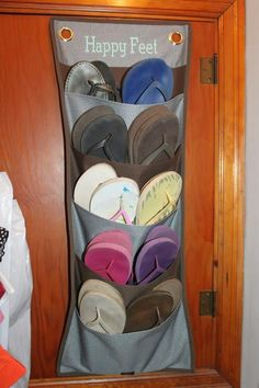 Genius!  Store your flip flops in the Thirty One Hang-Ups Family Organizer!