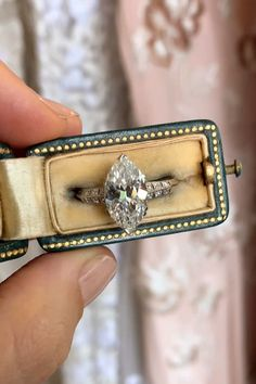 verlobungsring videos Antique Edwardian engagement ring set with a carat marquise-cut diamond with GIA certificate stating the diamond is J clarity with 6 single-cut diamonds accenting each shoulder to the platinum band. Set in platinum. Pink Wedding Rings, Wedding Rings Vintage, Vintage Engagement Rings, Diamond Engagement Rings, Pink Rings, Silver Rings, Unusual Engagement Rings, Wedding Band, Body Jewelry