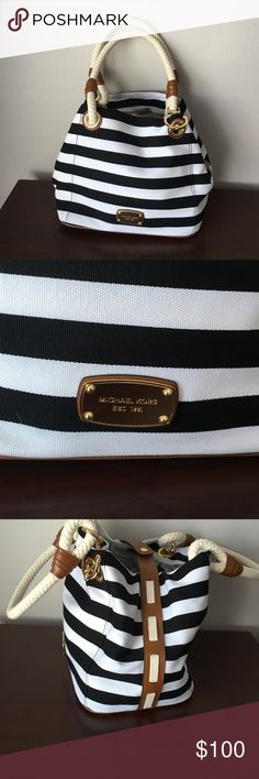 Authentic Michael Kors purse Nautical themed Michael Kors canvas purse. It was only used once in great condition. A little dirt on white stipe on the bottom left. Shown in first picture. Michael Kors Bags