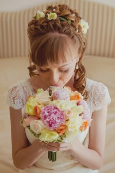 Romantic wedding haistyle with flowers and braids