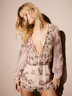 Mimi Playsuit | Stunning playsuit featuring an ornate design with shimmering sequin accents throughout with beautiful frayed edges. * Deep plunging neckline with front ties * Sheer sleeves with elastic at the cuffs * Elastic waist * Lined
